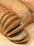 Loaves of bread. Three loaves of bread, one sliced. (9 x 12 image stock photography