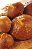 Loaves of bread. Small and large round loaves of sourdough bread royalty free stock photos