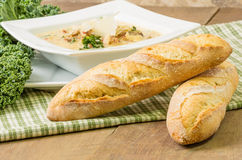 Loaves of bread with bowl of soup Royalty Free Stock Photography