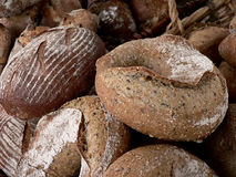 Loaves of bread at a farmers' market. Loaves of artisanal bread on display at a farmers' market royalty free stock photos