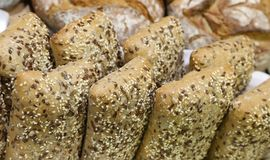Loaves of bread made with whole wheat to the seeds and cereals a. Many loaves of bread made with whole wheat to the seeds and cereals above Stock Photos