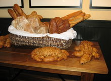 Loaves of bread. The picture shows loaves of bread placed on a shelf covered with linen or a similar fabric at room temperature stock photo