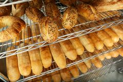 Loaves of bread on shelving. In bakery Stock Image