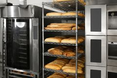 Loaves of bread on shelving. In bakery Stock Photography