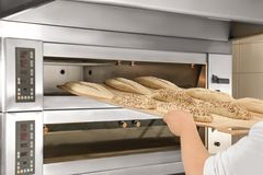 Loaves of bread on shelving. In bakery Stock Photos