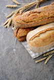 Loaves of bread on slate Stock Photos