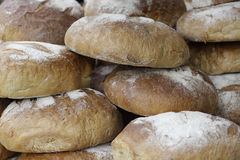 Loaves of bread. Stack of loaves of bread in the market royalty free stock photo