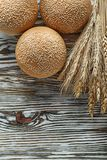 Loaves of bread wheat ears on vintage wooden surface Royalty Free Stock Image