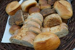 Loaves of bread. Wicker basket full of loaves of bread royalty free stock photos