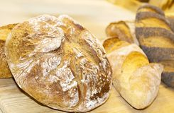 Loaves of flour with the addition of poppy seeds, sesame seeds,. Bakery products are made of flour with the addition of poppy seeds, sesame seeds, raisins and royalty free stock image