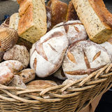 Loaves of fresh bread at the market Stock Images
