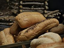 Loaves of freshly baked bread. Pile of appetizing loaves of fresh bread stock photos