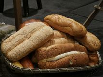 Loaves of freshly baked bread. Tempting loaves of assorted bread in a wicker basket royalty free stock photography