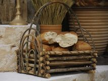 Loaves of freshly baked bread. Wooden tray with loaves of bread in a stage set royalty free stock photography