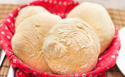 Loaves freshly baked homemade bread red basket Stock Photos