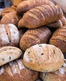 Loaves of Freshly baked wholemeal and sourdough bread. Variety of freshly baked loaves of bread stock photos