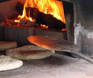 Loaves and pieces of bread cooked in the wood-fired oven Royalty Free Stock Photography