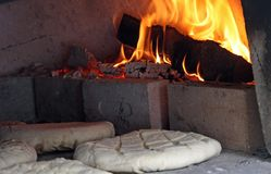 Loaves and pieces of bread cooked in the wood-fired oven Stock Image