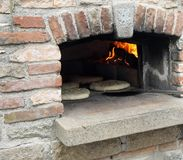 Loaves and pieces of bread cooked in the wood-fired oven Stock Photography