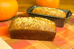 Loaves of pumpkin bread with pumpkins. Loaves of fresh pumpkin bread with pumpkins royalty free stock image