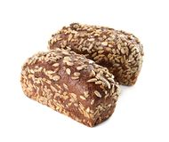 Loaves of rye bread with sunflower seeds isolated. On white royalty free stock photos
