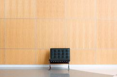 Lobby. Single chair against wall in a lobby Royalty Free Stock Photo