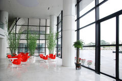 Lobby. Company lobby with red chairs and big windows Stock Photography