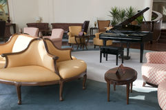 Lobby bar with piano and chairs Royalty Free Stock Photos