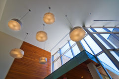 Lobby ceiling. Interior ceiling with hanging lamps in office building lobby royalty free stock image