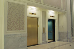 Lobby elevators. Looking at twin elevators on first floor, one is open Royalty Free Stock Photo