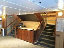 Lobby on the Galapagos Legend. GALAPAGOS, ECUADOR - FEBRUARY 20, 2017: Lobby aboard the Galapagos Legend Cruise Ship. The luxury ship plies the waters of the royalty free stock photos