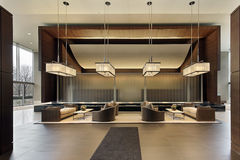 Lobby of high rise. Building with seating area stock photography