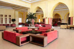Lobby in hotel. With red sofas Stock Images