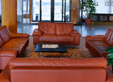Lobby with leather sofas Royalty Free Stock Photography