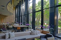 Lobby of a Luxury Hotel waiting lounge area with view of a beautiful outdoor garden