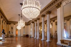 The lobby of the Milan Opera Theater La Scala with beautiful chandeliers and celebrity busts stock photos