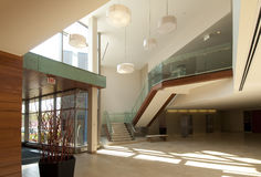 Lobby in a modern building. Modern office building lobby in marble, glass and mahogany Royalty Free Stock Photography