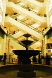 Lobby of the Old Marshal Fields De[department Store. The water fountain and diagonal escalators a features in the newer wing of Macy`s department Store in Stock Photo