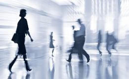 Lobby in the rush hour. Is made in the manner of blur and a blue tonality stock photography