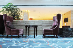 The lobby sofas and table. The flannelette sofas and round wood table Royalty Free Stock Photography