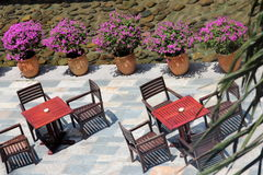 Lobby view from above. View from above two tables with chairs and pink flower in pots on the back Stock Photo