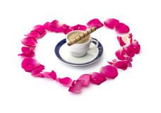 The lobes of roses which are laid out and cup of coffee, subject love Stock Photo