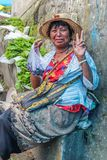 Lobesa Village, Punakha, Bhutan - September 11, 2016: Unidentified smiling woman at weekly farmers market. Royalty Free Stock Image