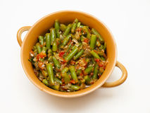 Lobio. With green beans in a brown bowl on a white background royalty free stock photography