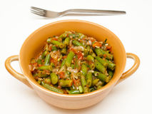 Lobio. With green beans in a brown bowl on a white background royalty free stock images