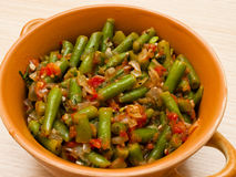 Lobio. With green beans in a brown bowl on a white background stock photo