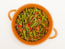 Lobio. With green beans in a brown bowl on a white background royalty free stock photo
