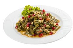 Lobio from green beans on a white plate. On white background stock photo