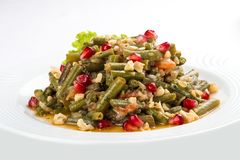 Lobio from green beans on a white plate royalty free stock photo