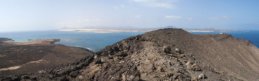 Lobos Island, Fuerteventura, Canary Islands, Spain, footpath, desert, landscape, mountain, volcano, Ocean. The view seen from the top of Caldera mountain of Royalty Free Stock Image
